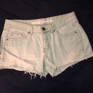 teal-dyed denim shorts